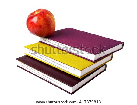 Concept of education. A red apple on top of a stack of the books - stock photo