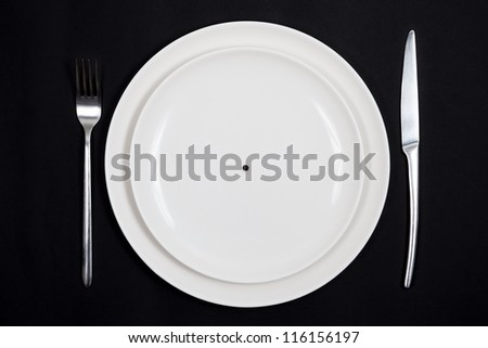 Concept of extreme diet. Dish with only a grain of pepper on it. - stock photo