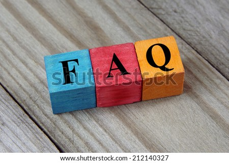 concept of FAQ word on wooden colorful cubes  - stock photo