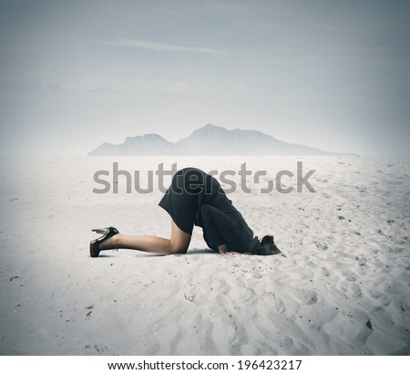 Concept of fear with businesswoman like an ostrich - stock photo