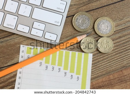 concept of finance, with money, stationery and chart in the background  - stock photo
