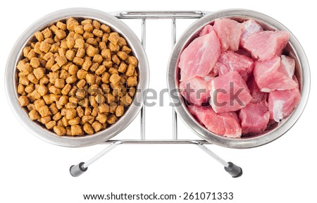 Concept of food for pets. Natural and dry food in metal bowls isolated on white background. File contains a clipping path. - stock photo