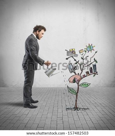 Concept of Growing company with sketch of a plant with business symbol - stock photo