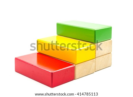 Concept of growth in business,stack of wooden block isolated on white background - stock photo
