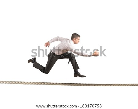 Concept of hard business with running businessman - stock photo