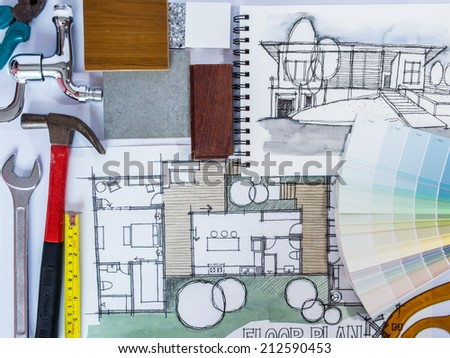 Concept of  home renovation with architecture drawing , material sample and work tools - stock photo