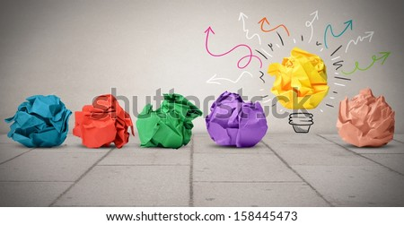 Concept of idea with colorful crumpled paper - stock photo