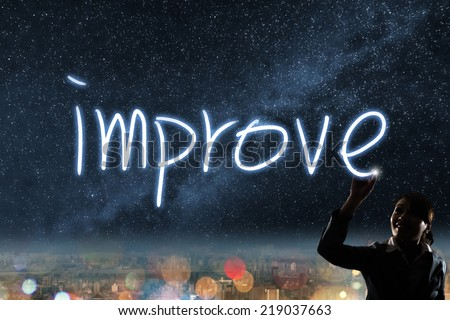Concept of improve, silhouette asian business woman light drawing. - stock photo