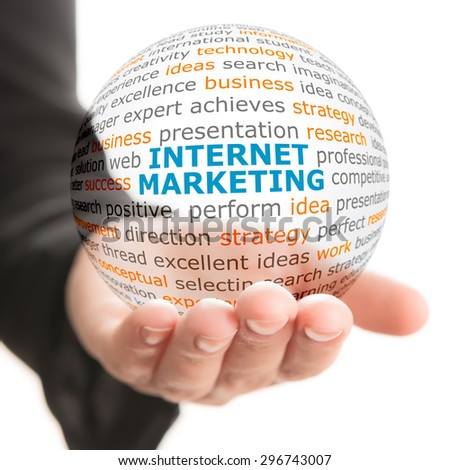 Concept of Internet marketing in business. Words on the transparent ball in the hand. - stock photo