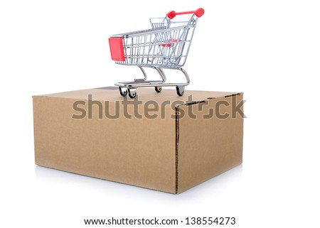 concept of internet shopping of a push cart isolated on top of a package - stock photo