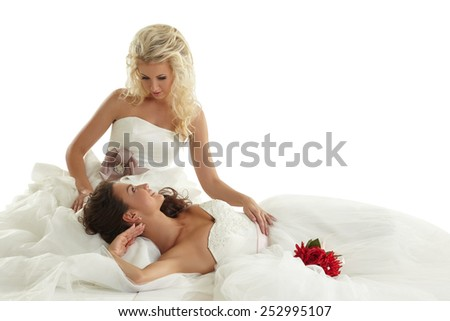 Concept of lesbian wedding. Two alluring brides - stock photo