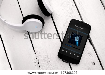 Concept of listening music from smartphone with wireless technology. - stock photo