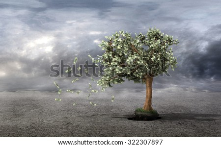 Concept of loss your money. Hand picks the money tree is taken from the earth on a grey clouds background. Loss profit. Losing your savings and managing your debt and financial budget. - stock photo