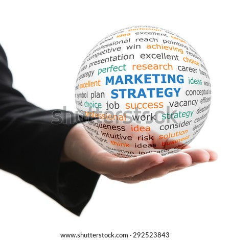 Concept of Marketing strategy in business. Words on the transparent ball in the hand - stock photo