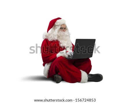 Concept of modern Santa Claus with laptop - stock photo