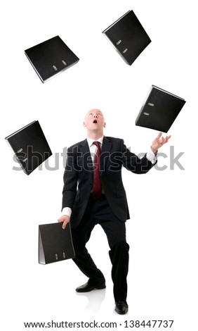 Concept of multi tasking in business, man juggling files isolated on white background. - stock photo