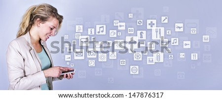Concept of multimedia smartphone with young woman - stock photo