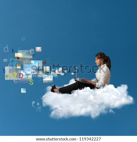 Concept of multimedia with a businesswoman over a cloud with a laptop - stock photo
