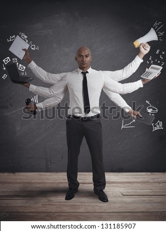 Concept of multitasking businessman - stock photo