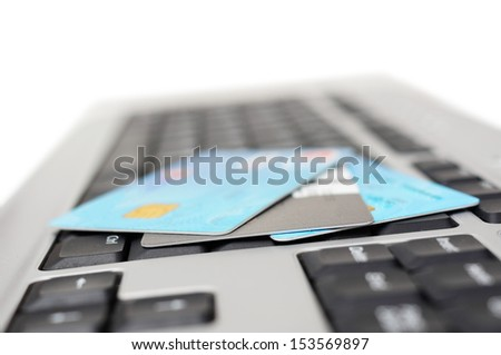 Concept of online shopping with keyboard and credit cards - stock photo
