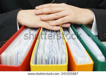 concept of paperwork,accounting, administration businessman holding documentation - stock photo