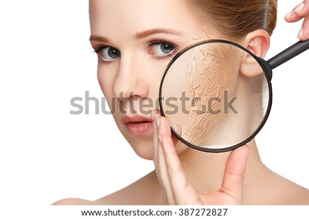 concept of rejuvenation and skincare. face of a beautiful girl with a problem skin and magnifier - stock photo
