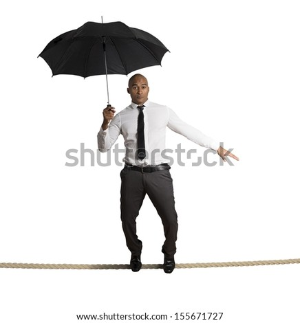 Concept of risk in business with businessman on the rope - stock photo