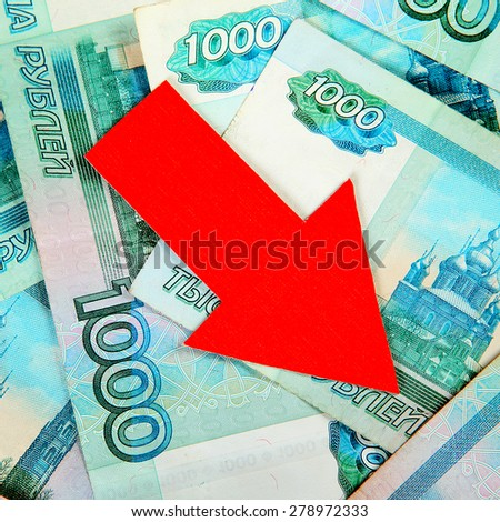 Concept of Russian Rubles and Red Arrow Down closeup - stock photo