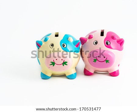 Concept of saving together. Couple of piggybanks together in saving money - stock photo