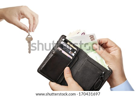 Concept of selling property - two businessmen hands giving each other modern key and cash money (Euro banknotes) while selling/buying or letting/renting real estate, isolated over white background  - stock photo
