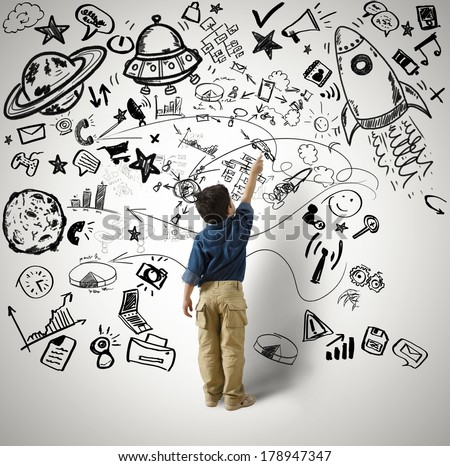 Concept of small genius with kid and various drawings - stock photo