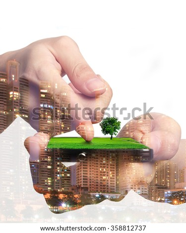 Concept of smart phone share green nature to urban life. Double layers view of city scape and indoor hand image. - stock photo