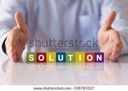 Concept of SOLUTION Word on Colorful Wooden Cubes - stock photo