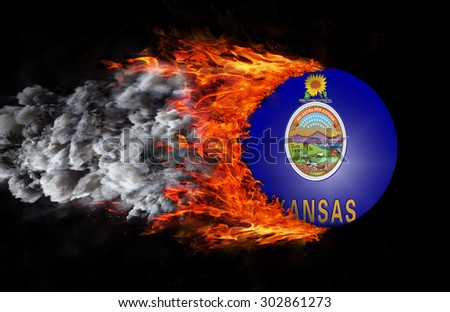 Concept of speed - Flag with a trail of fire and smoke - Kansas - stock photo
