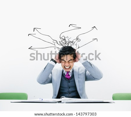 Concept of stress with businessman - stock photo