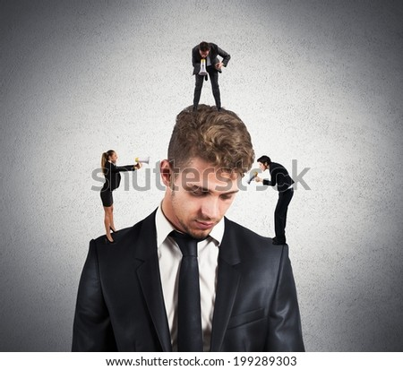 Concept of stressed man due to colleagues - stock photo
