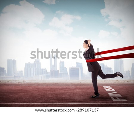 Concept of successful asian business woman in a finishing line - stock photo