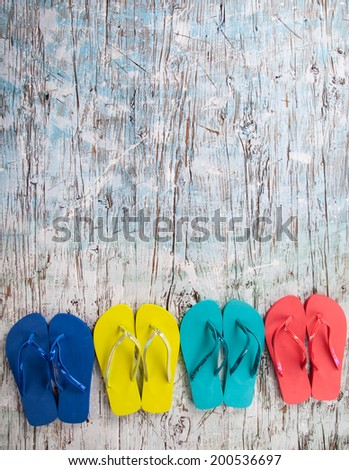 Concept of summer sandals on wood, shot from upper view - stock photo