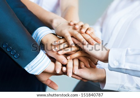 concept of teamwork. business people joined hands - stock photo