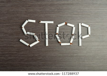 """concept of the dangers of smoking. the word """"stop"""" of cigarettes - stock photo"""