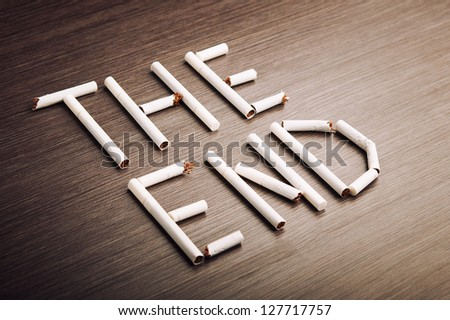 "concept of the dangers of smoking. the word ""the end"" of cigarettes - stock photo"