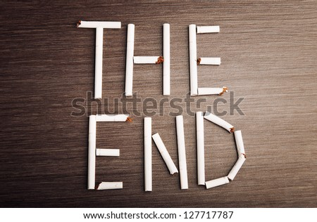 """concept of the dangers of smoking. the word """"the end"""" of cigarettes - stock photo"""