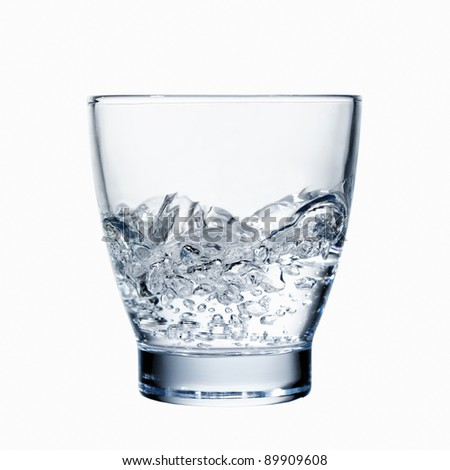 concept of the proverb 'storm in a teacup' or 'storm in a glass of water' - stock photo