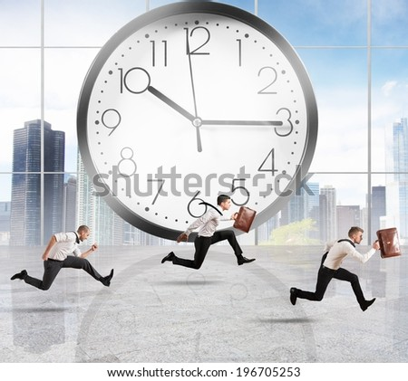 Concept of time and delay with running businessman - stock photo