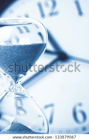 Concept of time - Hourglass and clock - stock photo