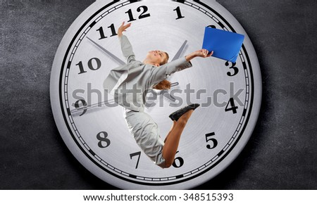 Concept of time with funny businesswoman running in a hurry - stock photo