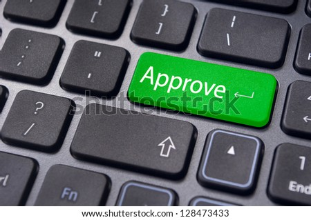 concept of to approve something, with message on enter key of keyboard. - stock photo