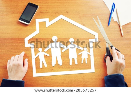 Concept of traditional family in their own home - stock photo