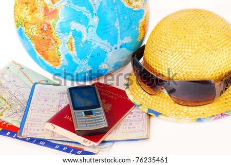 concept of traveling all over the world with mobile phone,passport,money,map and globe isolated on white - stock photo