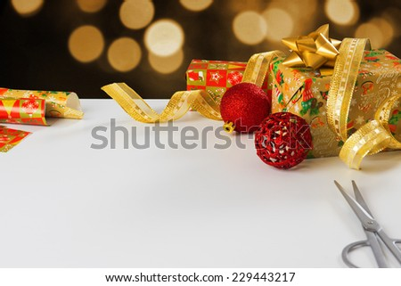 Concept of wrapping presents and gifts with white table copyspace - stock photo